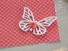 Le decorazioni: farfalla in gomma crepla e bottone in madreperla